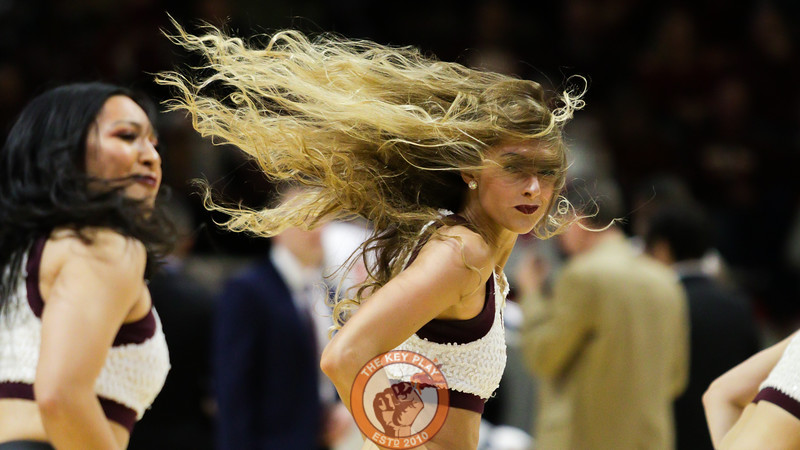 A member of the High Techs spins during a routine in a media timeout. (Mark Umansky/TheKeyPlay.com)