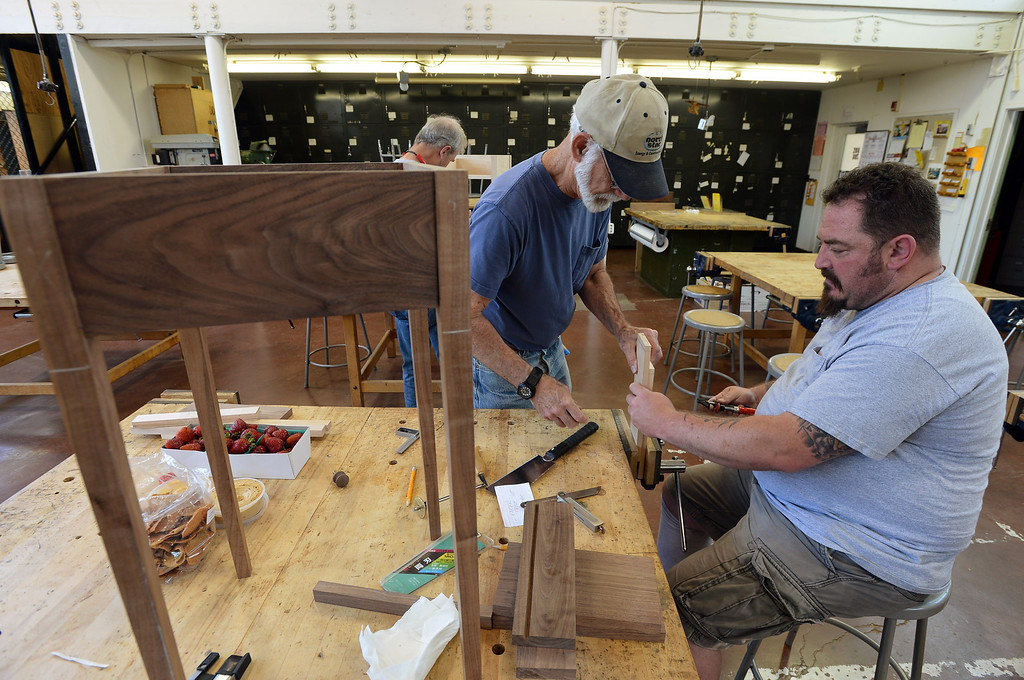 . Jason Deitch, right, gets help from Harold Mantle as he cuts dovetail joints for a woodworking project in Pleasant Hill, Calif. on Wednesday, July 24, 2013. The Diablo Woodworkers are reaching out to military veterans like Deitch and emphasizing the therapeutic qualities of woodworking. (Kristopher Skinner/Bay Area News Group)