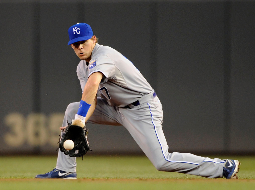 . Chris Getz #17 of the Kansas City Royals stops the ball hit by Pedro Florimon #25 of the Minnesota Twins during the third inning. (Photo by Hannah Foslien/Getty Images)