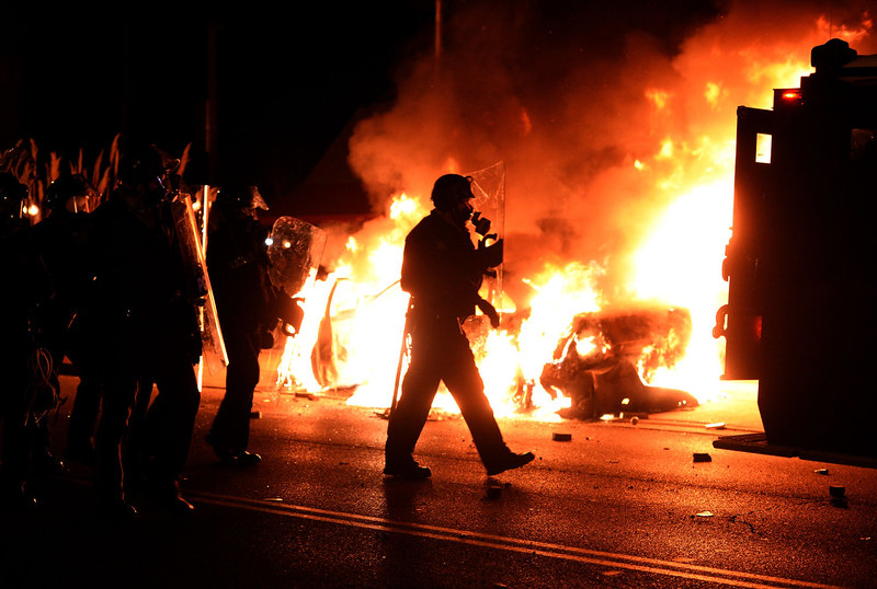 . A police car burns during clashes between police and protesters over the decision in the shooting death 18-year-old Michael Brown in Ferguson, Missouri, on November 24, 2014. US President Barack Obama urged calm as violent protests broke out on the streets of Ferguson after a grand jury decided a white policeman will not face charges for killing a black teen. JEWEL SAMAD/AFP/Getty Images