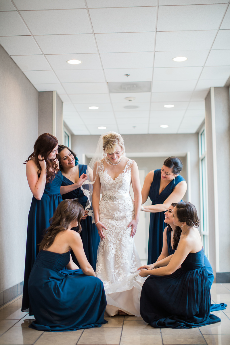 Meg and her bridesmaids get ready for her Bluemont Vineyard wedding. Photos by the best Washington DC wedding photographer Jalapeno Photography. The Catholic wedding ceremony was at St. Theresa Catholic Church in Ashburn, VA.
