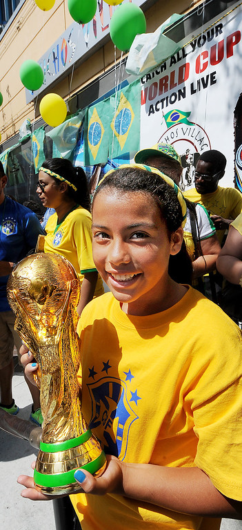 . Paula holding a World Cup trophy as she enters Gauchos Village, a Brazilian style restaurant in Glendale to party and watch live television broadcast  of World Cup action between Brazil  and Croatia in the World Cup Thursday, June 12, 2014.(Photo by Walt Mancini/Pasadena Star-News)