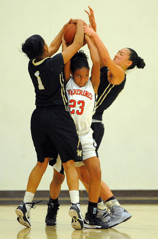 . STUDIO CITY - 02/16/13 - (Photo: Scott Varley, Los Angeles Newspaper Group)  CIF Southern Section Division IV-AA second-round girls basketball playoff game. Bishop Montgomery vs Harvard-Westlake. Bishop Montgomery won 57-42. BM\'s Lisa Washington, left, and Sophia Song strip the ball from Jordan Brown.