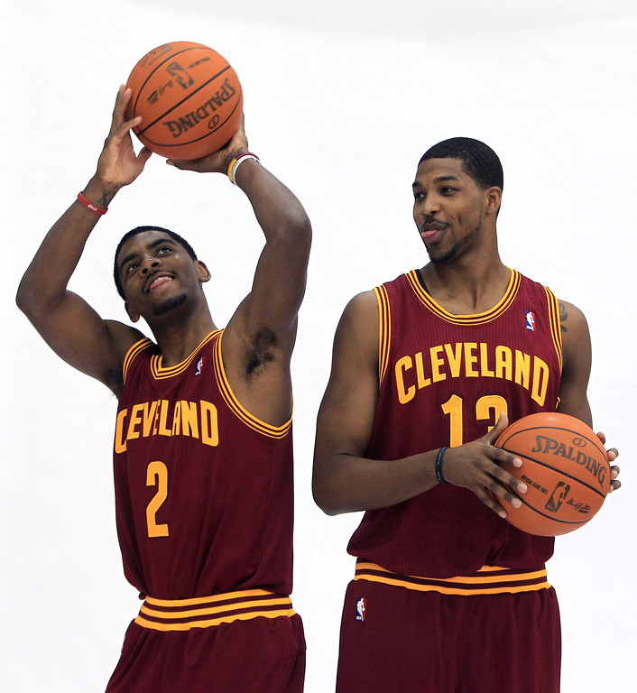. Cleveland Cavaliers\' Kyrie Irving, left, and Tristan Thompson joke around during media day at the NBA basketball team\'s training camp, Monday, Dec. 12, 2011, in Independence, Ohio. (AP Photo/Tony Dejak)
