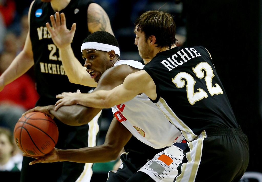 . BUFFALO, NY - MARCH 20: Austin Richie #22 of the Western Michigan Broncos defends against C.J. Fair #5 of the Syracuse Orange during the second round of the 2014 NCAA Men\'s Basketball Tournament at the First Niagara Center on March 20, 2014 in Buffalo, New York.  (Photo by Elsa/Getty Images)