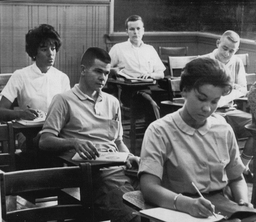 . Vivian Malone, left, sits with white students in algebra class in Comer Hall at the University of Alabama at Tuscaloosa. 1963. (Denver Post Archive)