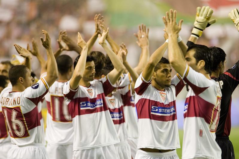 Sevilla FC players greeting the spectators