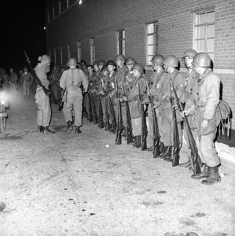 . Ohio National Guardsmen, with bayonets affixed to rifles, line up at an assembly point at East 107th Street and Chester Avenue, near Fifth district police headquarters in Cleveland, Ohio, July 21, 1966. This is on the fringe of the riot-troubled Hough area. (AP Photo)