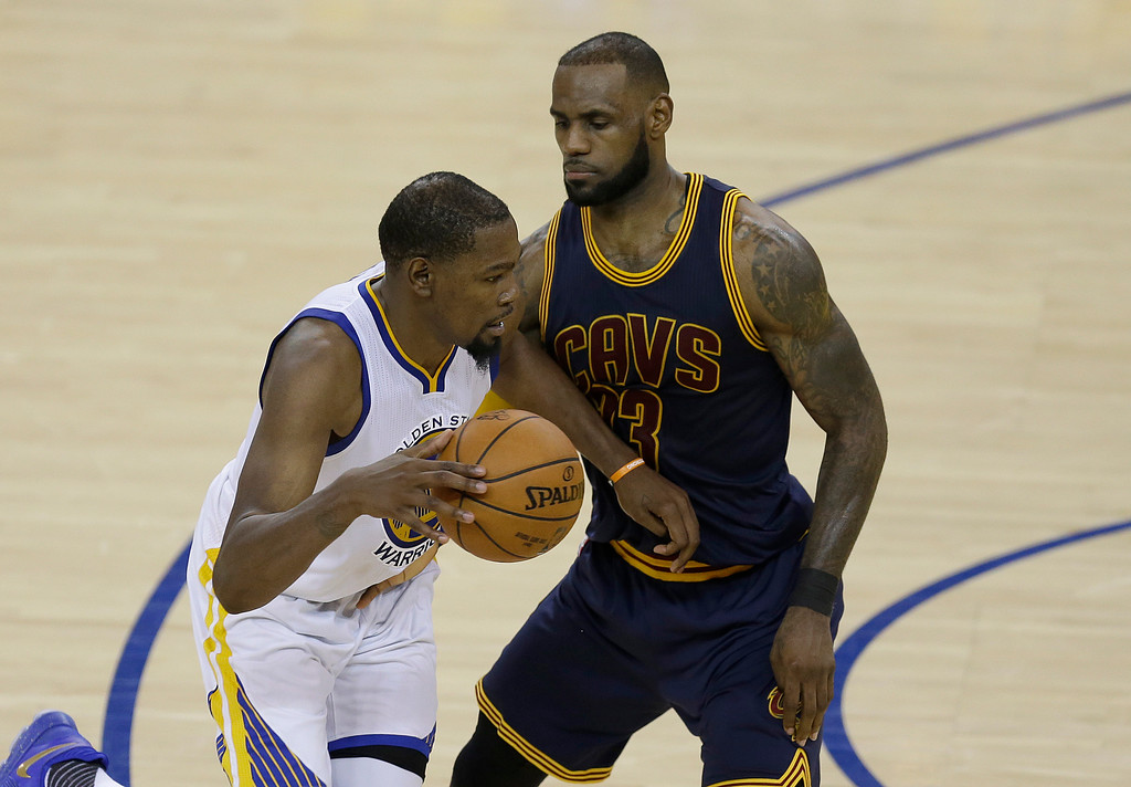 . Golden State Warriors forward Kevin Durant, left, drives on Cleveland Cavaliers forward LeBron James during the second half of Game 1 of basketball\'s NBA Finals in Oakland, Calif., Thursday, June 1, 2017. (AP Photo/Ben Margot)