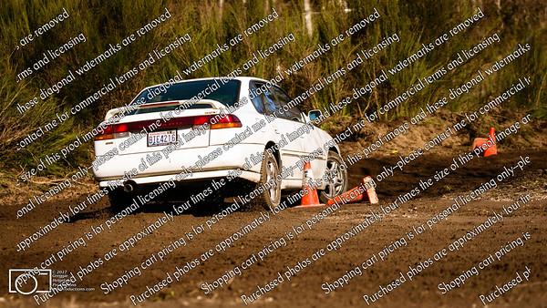 5 White Subaru Legacy Sedan