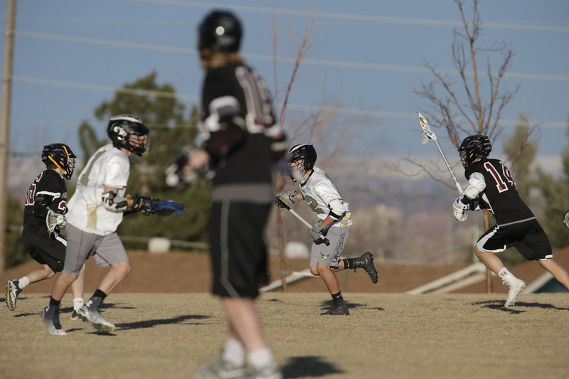 JPM0563-JPM0563-Jonathan first HS lacrosse game March 9th.jpg