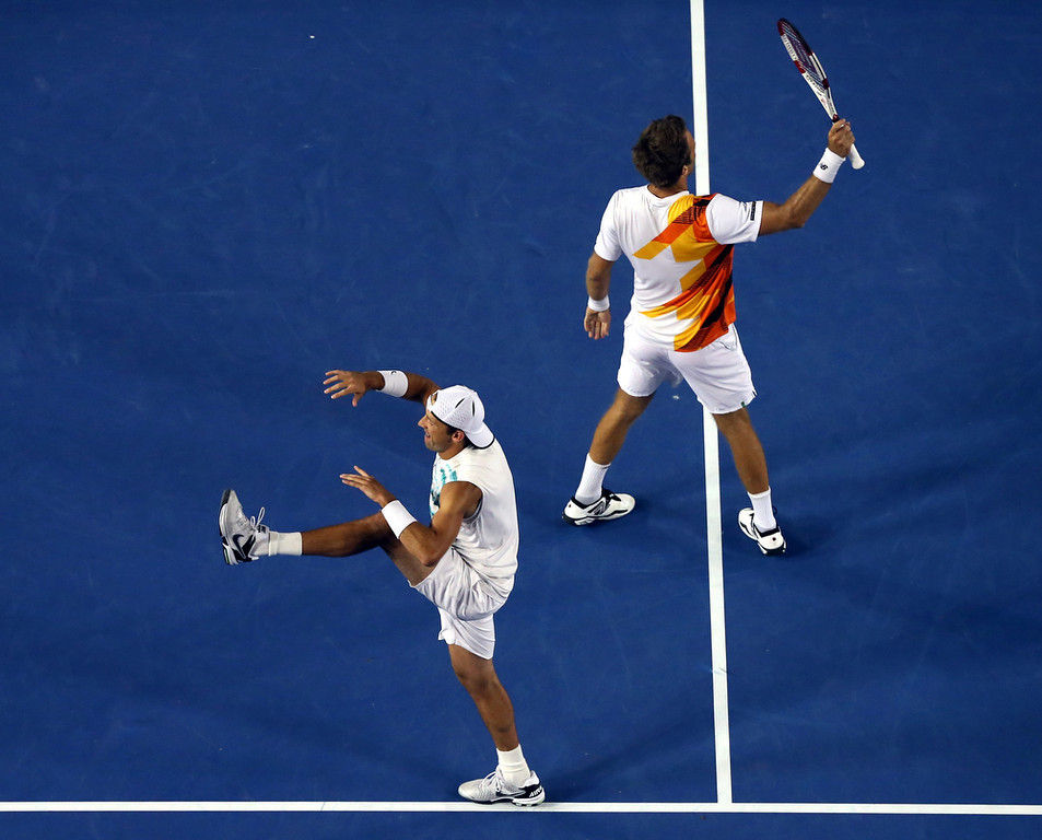 . Lukasz Kubot of Poland, left, and  Robert Lindstedt of Sweden celebrate after defeating Eric Butorac of the U.S. and Raven Klaasen of South Africa in their men\'s doubles final at the Australian Open tennis championship in Melbourne, Australia, Saturday, Jan. 25, 2014.(AP Photo/Eugene Hoshiko)
