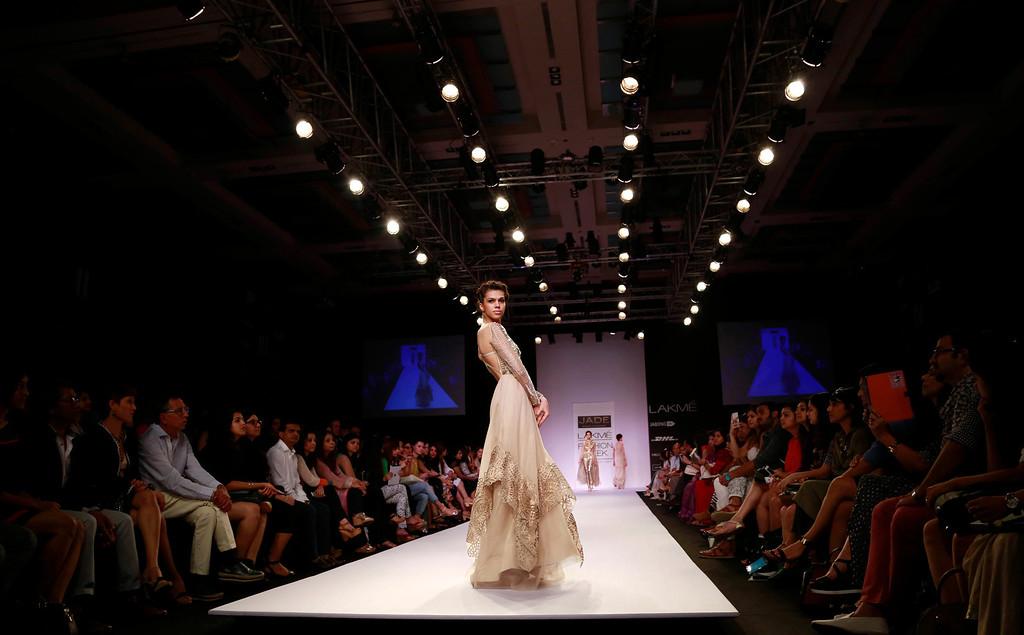 . A model displays a creation by Monica and Karishma during the Lakme Fashion Week in Mumbai, India, Thursday, March 13, 2014. (AP Photo/Rafiq Maqbool)