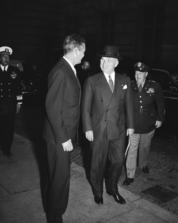 . President Harry Truman talks with a leader at a NATO meeting. (AP)