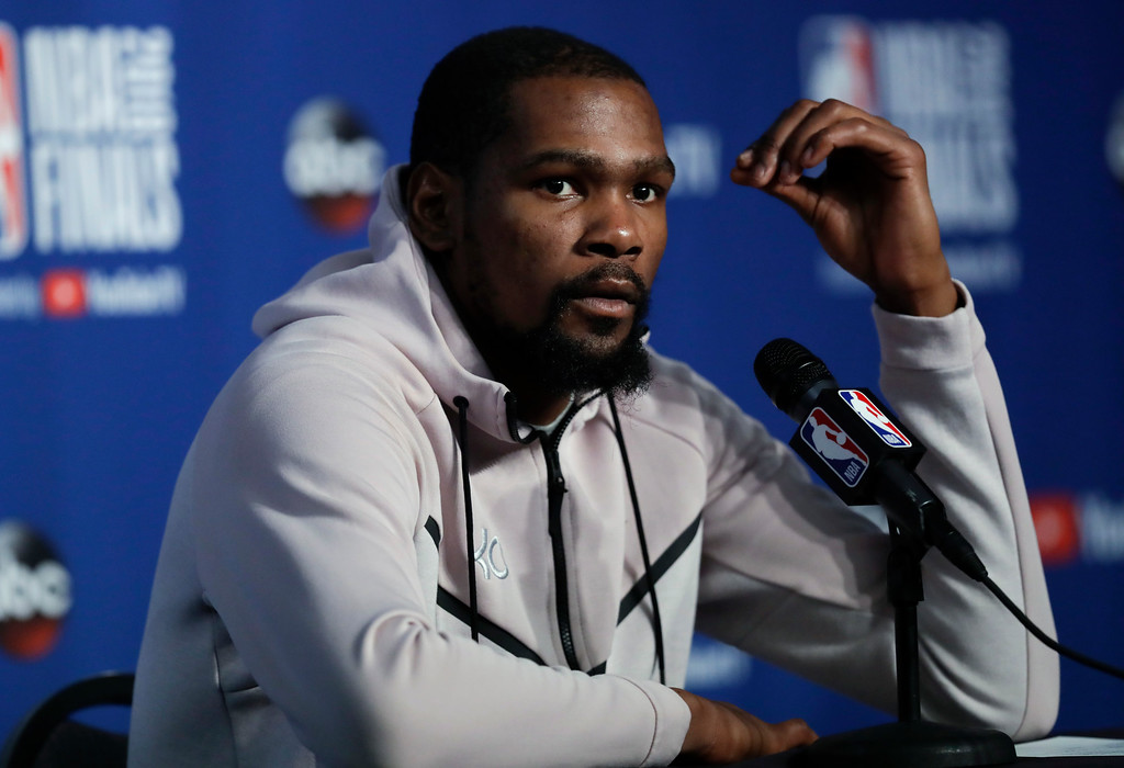 . Golden State Warriors forward Kevin Durant attends a news conference following Game 3 of basketball\'s NBA Finals, early Wednesday June 7, 2018, in Cleveland. The Warriors defeated the Cleveland Cavaliers 110-102 to take a 3-0 lead in the series. (AP Photo/Tony Dejak)
