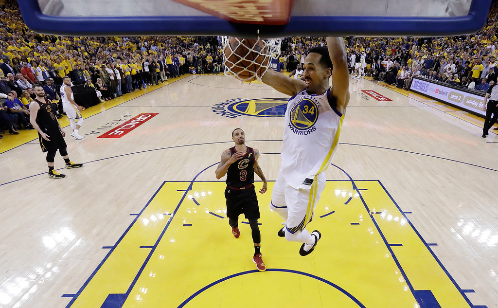 . Golden State Warriors\' Shaun Livingston (34) dunks past Cleveland Cavaliers\' George Hill (3) during the second half of Game 1 of basketball\'s NBA Finals Thursday, May 31, 2018, in Oakland, Calif. (AP Photo/Marcio Jose Sanchez)