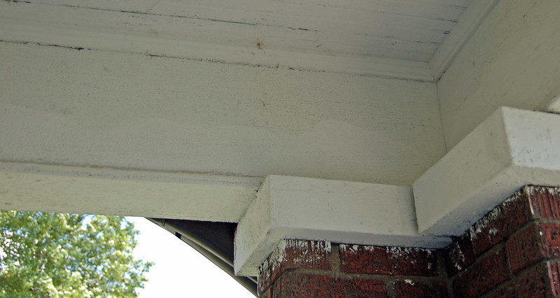 Another shot of porch paint failure and uneven previous paint job.
