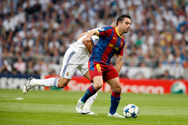 Xavi with the ball, UEFA Champions League Semifinals game between Real Madrid and FC Barcelona, Bernabeu Stadiumn, Madrid, Spain