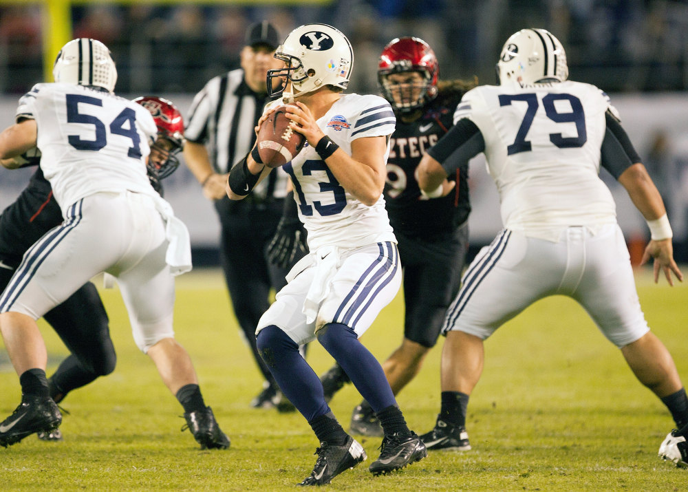 . Riley Nelson #13 of the BYU Cougars looks to throw the ball in the first half of the game against the San Diego State Aztecs in the Poinsettia Bowl at Qualcomm Stadium on December 20, 2012 in San Diego, California. (Photo by Kent C. Horner/Getty Images)