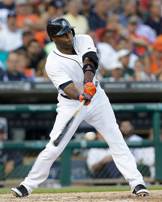 . Detroit Tigers\'  Torii Hunter hits a single against the Kansas City Royals in the fourth inning of a baseball game in Detroit, Monday, June 16, 2014. Hunter left the game with an injury after running to first base. (AP Photo/Paul Sancya)