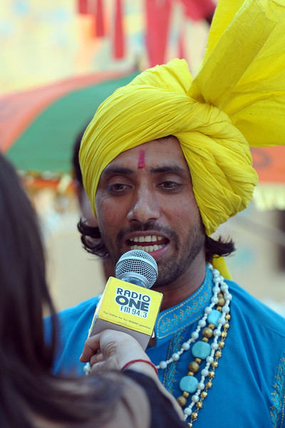 Lead dancer from the Haryanvi Group being interviewed on Radio One FM 94.3 near the open theatre called Chaupal at Suraj Kund Mela 2009 held in Haryana (outskirts of Delhi), North India. The Suraj Kund Mela is an annual fair held near Delhi. Folk dances, handicrafts and a lot of fun.
