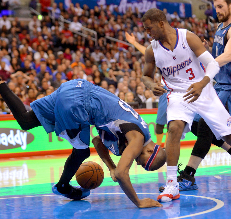 . Los Angeles Clippers\' Chris Paul knocks the ball away from Corey Brewer of the Minnesota Timberwolves Monday, Nov. 11, 2013, in Los Angeles.  The Clippers won the game 109-107.(Andy Holzman/Los Angeles Daily News)