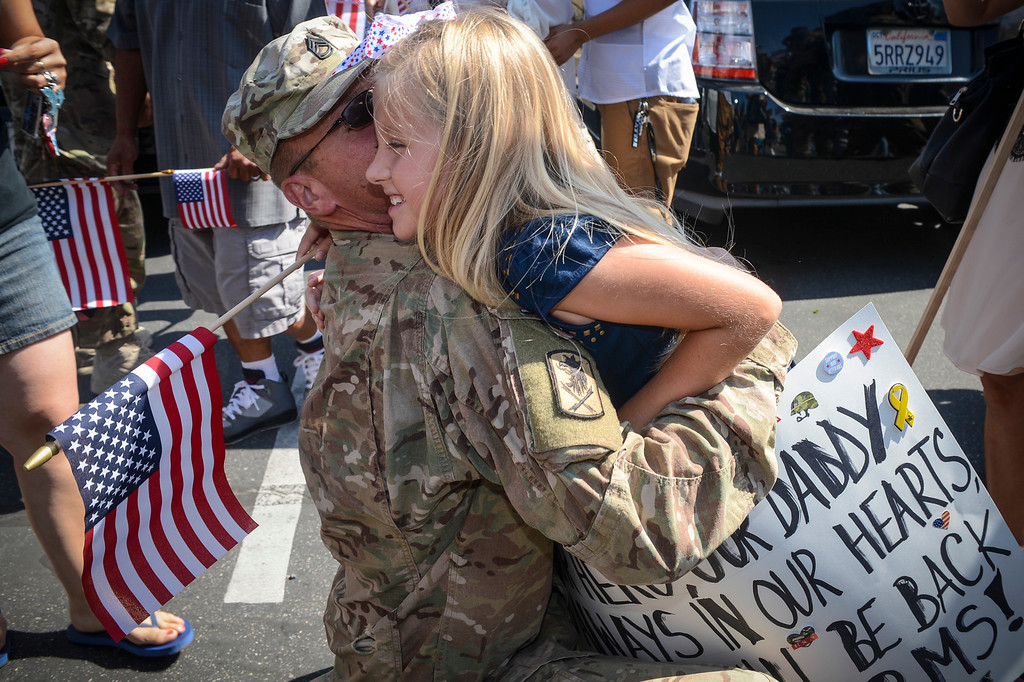. Kimberly Kisielewski of San Pedro gives her father, Mark Kisielewski a big hug upon his arrival at the US Army Reserve Center in West Los Angeles Wednesday, September 18, 2013.  Kisielewski and 119 other reserve soldiers returned from a 12 month deployment in Kandahar, Afghanistan to the welcome arms of their loved ones.   ( Photo by David Crane/Los Angeles Daily News )