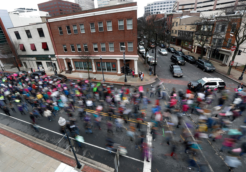 . People march to the New Jersey Statehouse during a rally in support of the national Women\'s March on Washington, Saturday, Jan. 21, 2017, in Trenton, N.J. The march was held in in conjunction with with similar events taking place around the nation following the inauguration of President Donald Trump. (AP Photo/Julio Cortez)