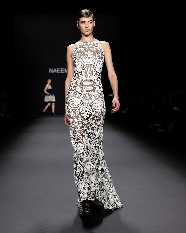 . The Naeem Khan Fall 2013 collection is modeled during Fashion Week in New York, Tuesday, Feb. 12, 2013.  (AP Photo/Kathy Willens)