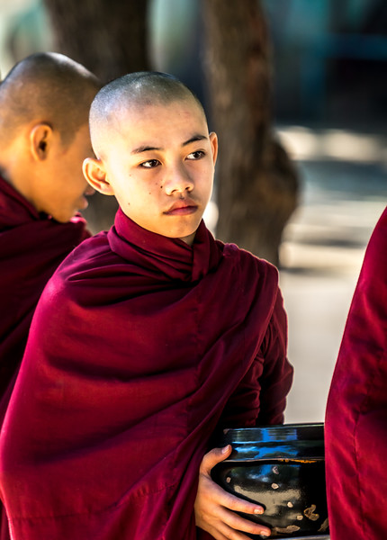 Novice Monk waiting online for the midday meal