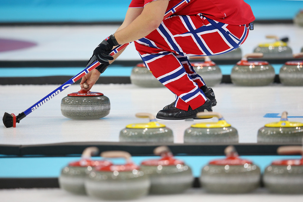 . SOCHI, RUSSIA - FEBRUARY 13:  A Norwegian curler prepares for a throw during the Curling Round Robin matches during day six of the Sochi 2014 Winter Olympics at Ice Cube Curling Center on February 13, 2014 in Sochi, Russia.  (Photo by Julian Finney/Getty Images)