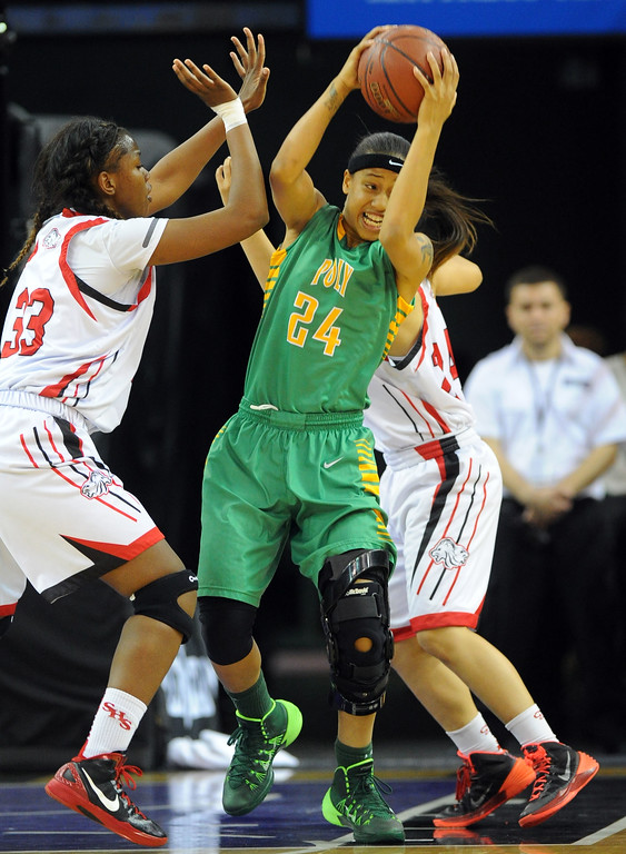 . Poly\'s Emoni Jackson grabs a defensive rebound at Sleep Train Arena in Sacramento, CA on Saturday, March 29, 2014. Long Beach Poly vs Salesian in the CIF Open Div girls basketball state final. 1st half. (Photo by Scott Varley, Daily Breeze)