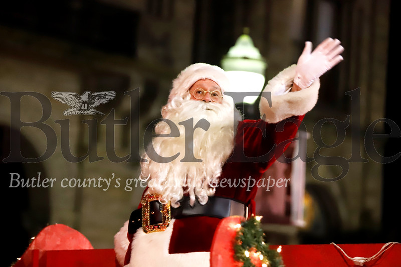 Santa waves to the crowd in front of the Butler County Courthouse during Butler's Spirit of Christmas Parade Saturday. Seb Foltz/Butler Eagle