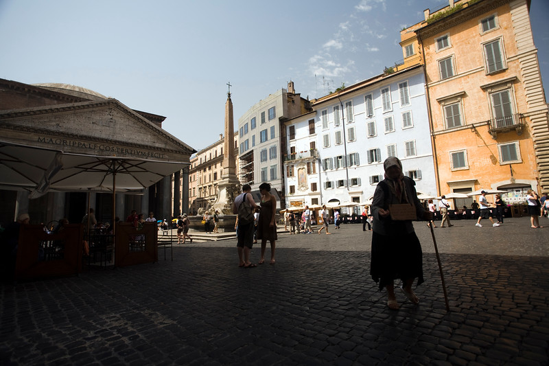 Beggar woman on Rotonda square, in front of the Pantheon, Rome
