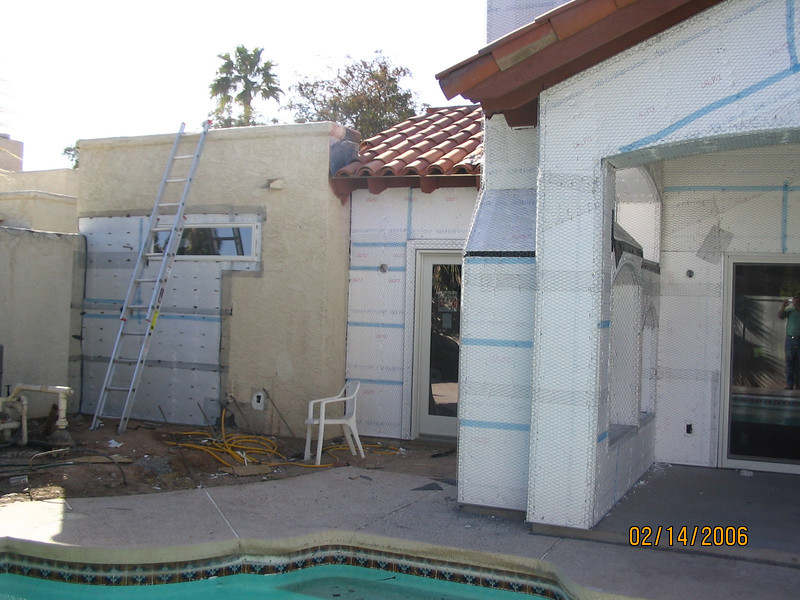 From left to right: outdoor shower, bedroom door, fireplace, patio.
