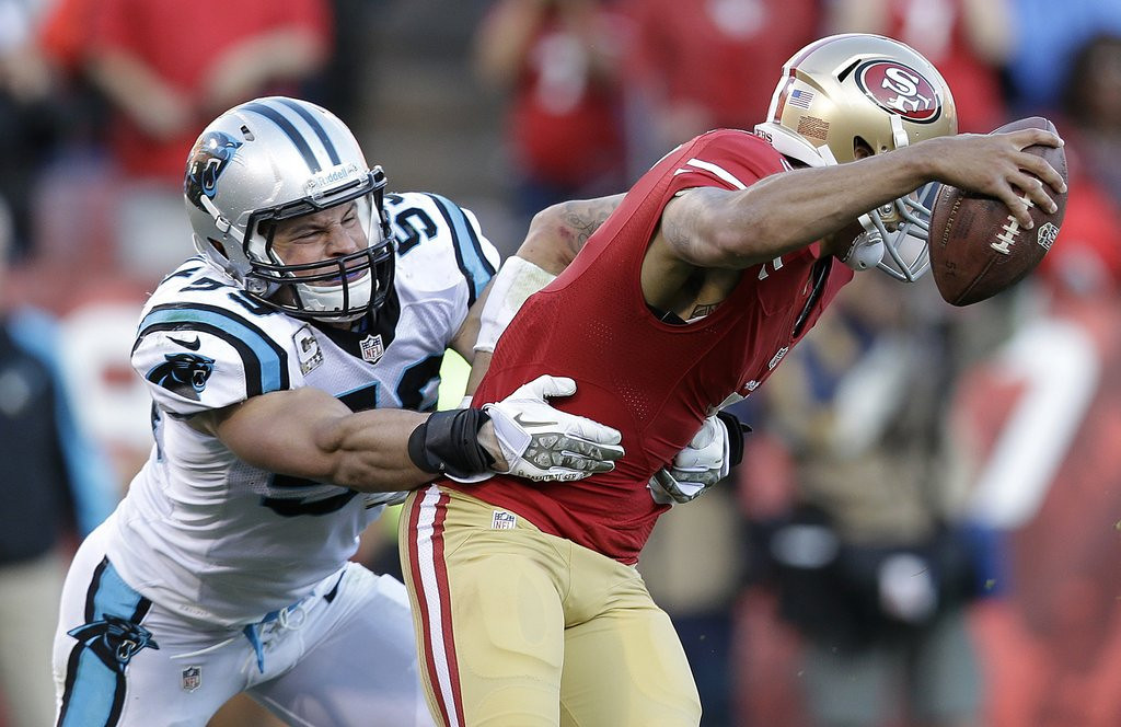 . <p><b> 49ers at Panthers (even):</b> <p>San Francisco quarterback Colin Kaepernick had to adjust his game in frigid Green Bay on Sunday. With temperatures expected in the 50s in balmy Charlotte on Sunday, he can go back to his usual routine of kissing his biceps after every play. <p>Pick: <b>49ers by 3</b> <p>   (AP Photo/Marcio Jose Sanchez, File)