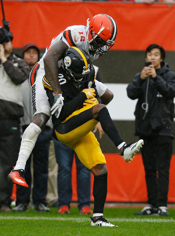 . Pittsburgh Steelers cornerback Cameron Sutton (20) intercepts pass in front of Cleveland Browns wide receiver Josh Gordon (12) during the second half of an NFL football game, Sunday, Sept. 9, 2018, in Cleveland. (AP Photo/Ron Schwane)