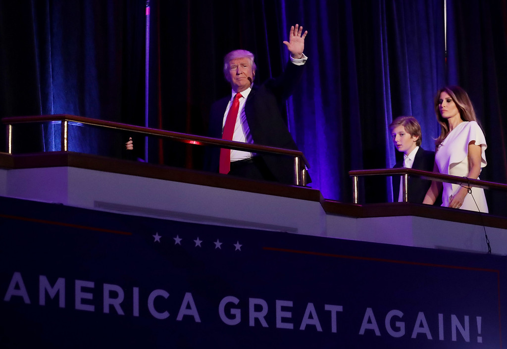 . NEW YORK, NY - NOVEMBER 09:  Republican president-elect Donald Trump acknowledges the crowd along with his son Barron Trump and his wife Melania Trump during his election night event at the New York Hilton Midtown in the early morning hours of November 9, 2016 in New York City. Donald Trump defeated Democratic presidential nominee Hillary Clinton to become the 45th president of the United States.  (Photo by Chip Somodevilla/Getty Images)
