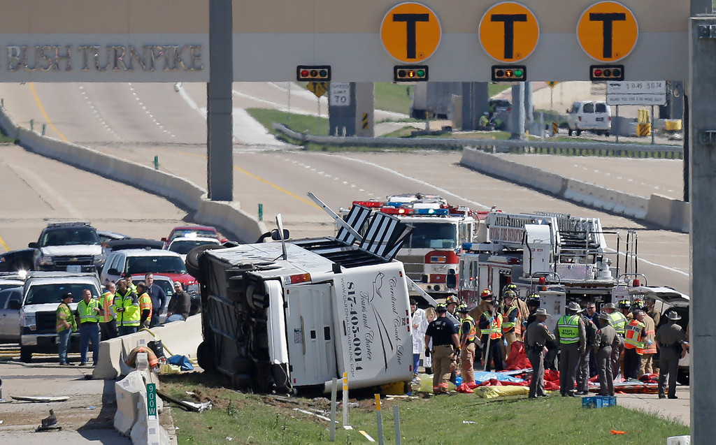 . Emergency responders works the scene of  bush crash on the George Bush Turnpike Thursday, April 11, 2013, in Irving, Texas. <br>  The chartered bus overturned on the busy highway near Dallas on killing at least two people and injuring several others, authorities said. (AP Photo/LM Otero)
