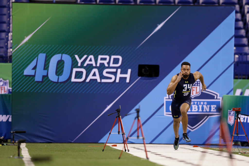 . Ohio State defensive back Marshon Lattimore runs the 40-yard dash at the NFL football scouting combine in Indianapolis, Monday, March 6, 2017. (AP Photo/Michael Conroy)