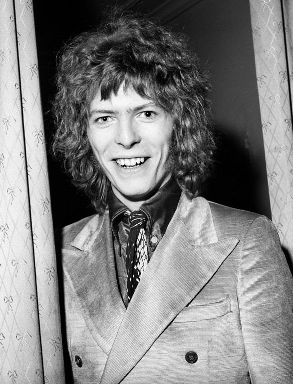 . FILE - This is a Feb. 13, 1970 file photo of David Bowie. Bowie, the other-worldly musician who broke pop and rock boundaries with his creative musicianship, nonconformity, striking visuals and a genre-bending persona he christened Ziggy Stardust, died of cancer Sunday Jan. 10, 2016. He was 69 and had just released a new album. (PA, File via AP) UNITED KINGDOM OUT  NO SALES NO ARCHIVE