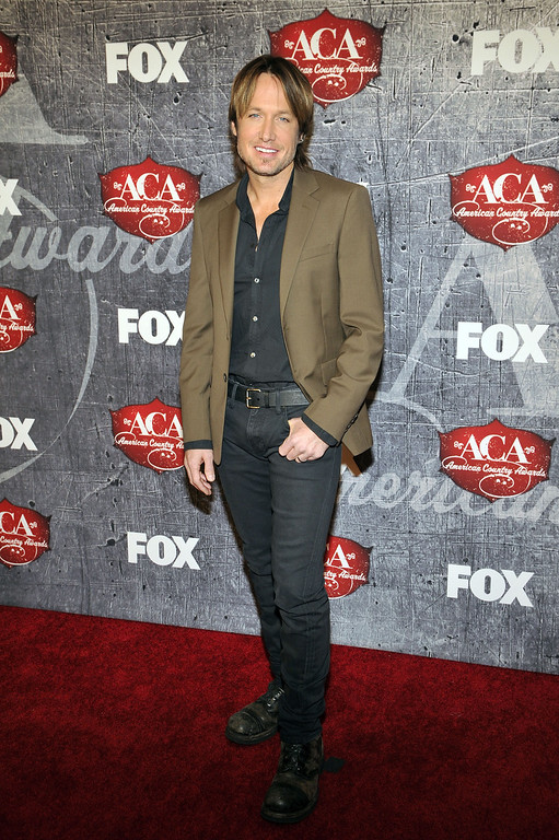 . Singer and songwriter Keith Urban arrives at the American Country Awards on Monday, Dec. 10, 2012, in Las Vegas. (Photo by Jeff Bottari/Invision/AP)
