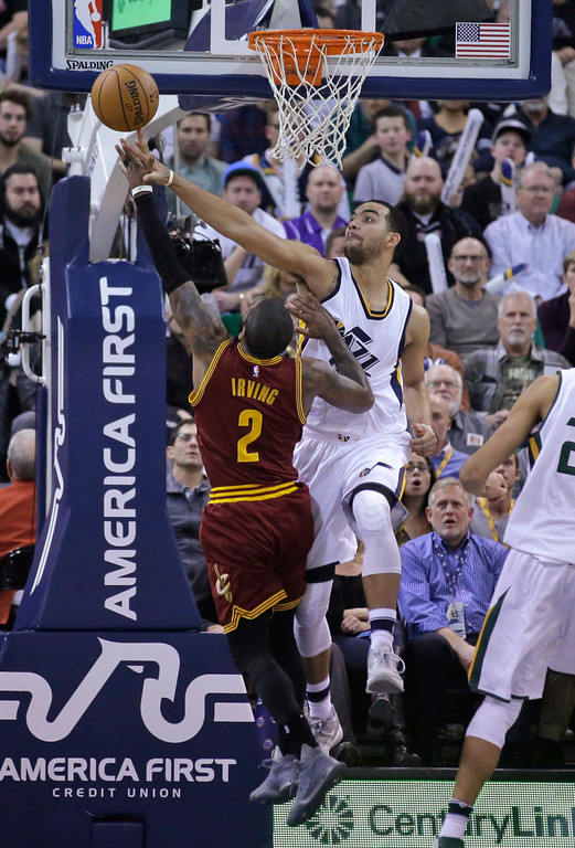 . Utah Jazz forward Trey Lyles, right, blocks the shot of Cleveland Cavaliers guard Kyrie Irving (2) during the second half of an NBA basketball game Tuesday, Jan. 10, 2017, in Salt Lake City. The Jazz won 100-92. (AP Photo/Rick Bowmer)