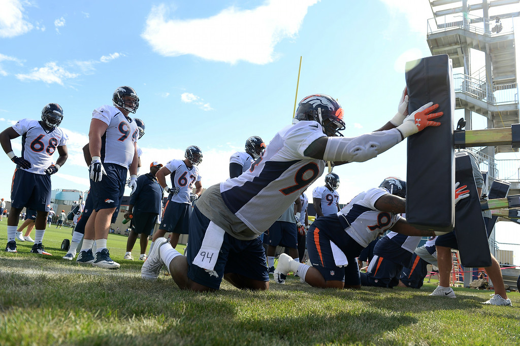 . Denver Broncos defensive end DeMarcus Ware (94) runs through drills on the first day of the Denver Broncos 2014 training camp July 24, 2014 at Dove Valley. (Photo by John Leyba/The Denver Post)