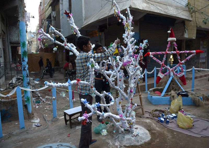 . Pakistani minority Christians decorate a Christmas tree in Karachi on December 24, 2014. Pakistan is overwhelmingly Muslim and at around two percent of the population, Christians are among the country\'s most marginalised citizens. ASIF HASSAN/AFP/Getty Images
