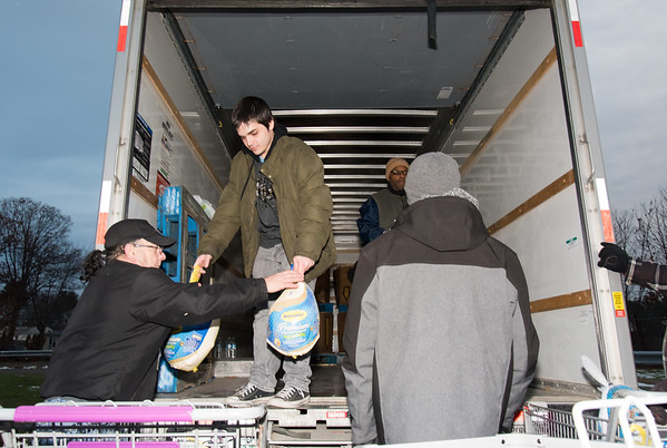 11/19/18 Wesley Bunnell | Staff HRA distributed Thanksgiving meals at their Osgood Ave location on Monday afternoon. Jeffrey Grimaldi from HRA helps unload turkeys from their donation truck.