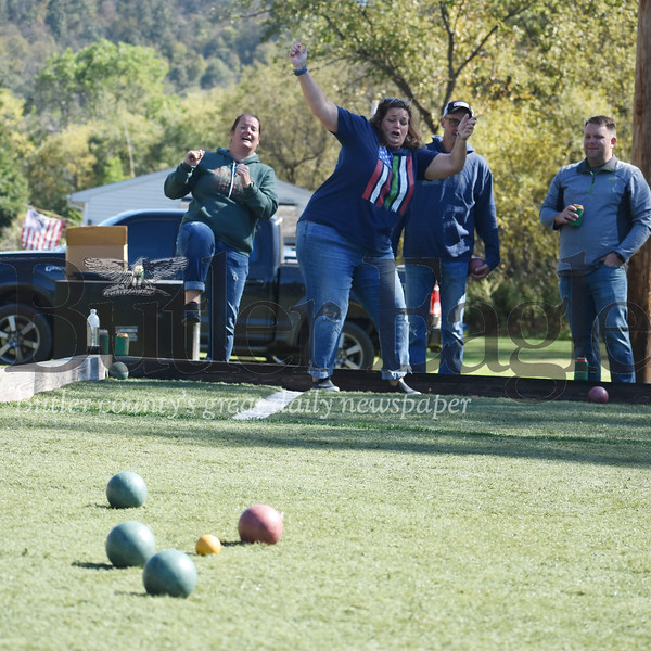Wendy Ammerman, of Pittsburgh, reacts to her shot during the annual Bocci Ball tournament at the East Brady Sons of Italy hall on Route 68 while her teammate, Gina Andreassi, formerly of Karns City, cheers her on. More than 100 people showed up for the hall's annual Columbus Day Celebration, with 15 teams of four participating in the all-day bocci ball tournament. Looking on were the women's opponents, East Brady residents Dan Slaugenhoup and Todd Lucas. Andie Hannon/Butler Eagle