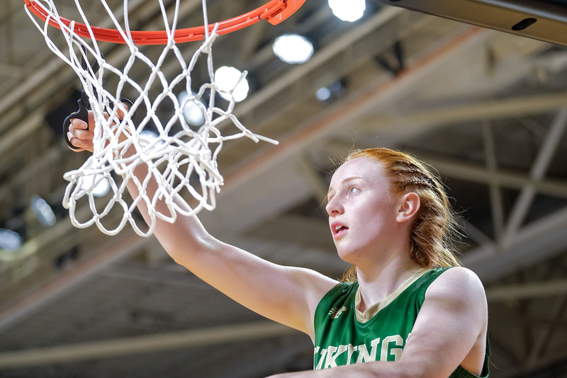 Oxford Hills' Julia Colby cuts the net.