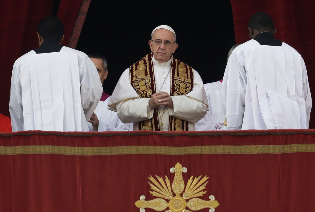 . Pope Francis holds his hands as he prepares to deliver the Urbi et Orbi (Latin for \' to the city and to the world\' ) Christmas\' day blessing from the main balcony of St. Peter\'s Basilica at the Vatican, Sunday, Dec. 25, 2016. (AP Photo/Alessandra Tarantino)