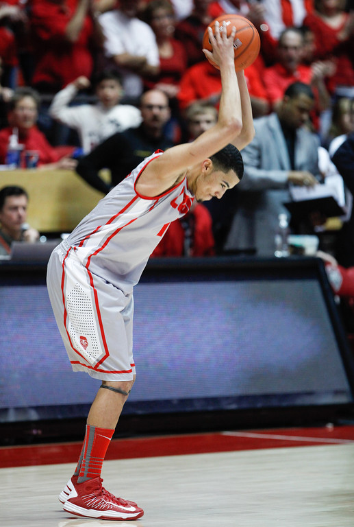 . New Mexico\'s Kendall Williams slams the ball down on the court at the end of an NCAA college basketball game against Wyoming in Albuquerque, N.M., Saturday, March 2, 2013. New Mexico won 53-42 in its home finale. (AP Photo/ Craig Fritz)